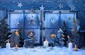 Outdoor christmas window decoration in blue with wood and candle — Stock Photo