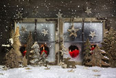 Mood and atmosphere: christmas window decoration in red with woo — Stock Photo