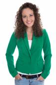Isolated smiling young business woman in green blazer with jeans — Stock Photo