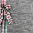 Country style christmas background with red green checked ribbon — Stock Photo #53614615