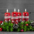 Advent wreath or crown with four red candles on wooden backgroun — Stock Photo #53894049