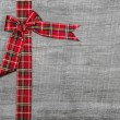 Red green checked ribbon on wooden background for christmas or o — Stock Photo #54198303