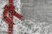 Country style christmas background with red green checked ribbon — Stock Photo