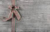 Red green checked ribbon on wooden background for christmas or o — Stock Photo
