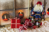 Santa claus with red presents: christmas country style window de — Stock Photo