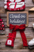 Opening hours on christmas holidays: closed, information for cus — Stock Photo