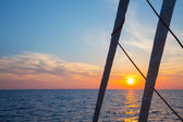 Sailing holidays: sunset with horizon while cruising with a sail — Stock Photo