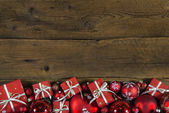Christmas frame or border with red presents on wooden old backgr — Stock Photo