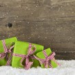 Apple green christmas presents on wooden background for a gift c — Stock Photo #54946767