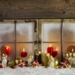 Classical christmas wooden window decoration with red candles an — Stock Photo #55048127
