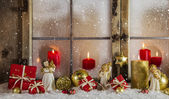Classical christmas wooden window decoration with red candles an — Stock Photo