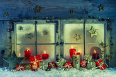 Old wooden window decorated for christmas with red candles and p — Stock Photo