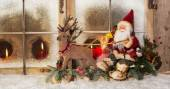Classical christmas decoration: santa claus riding on reindeer b — Stock Photo