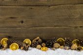 Natural christmas decoration with oranges, nuts and fir cone on  — Stock Photo