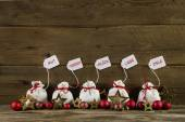 German christmas greetings with presents and text on wooden back — Stockfoto