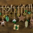 Rustic old christmas decoration on wood. Gold and brown colors. — Stock Photo #56032941
