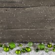 Rustic wooden country background with green christmas balls. — Photo #56034563