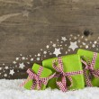 Green christmas presents on wooden background for a gift certifi — Stock Photo #56046619