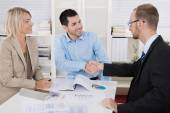 Customer appointment: business team with client making handshake — Stock Photo