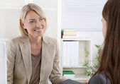 Female managing director in a job interview with a young woman. — Stok fotoğraf