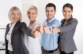 Successful business team in portrait: more woman as men with thu — Stock Photo