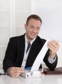 Happy entrepreneur looking at paper roll: concept for increasing — Stock Photo