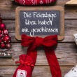 German text on a billboard: We have open on christmas holidays. — Stock Photo #56404227