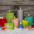 Colorful christmas decoration with presents and burning candles. — Stock Photo #56404245