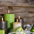 Four burning apple green christmas candles on wooden background. — Stok fotoğraf #56404311