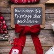 German text on a billboard: We have open on christmas holidays. — Stock Photo #56404883