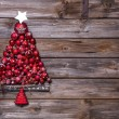Christmas tree of red balls on wooden background. — Stock Photo #56405447