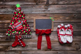 Wooden christmas background with red decoration and an empty boa — Stock Photo