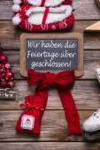 German text on a billboard: We have open on christmas holidays.  — Stock Photo