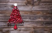 Christmas tree of red balls on wooden background. — Stock Photo