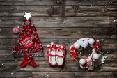 Wooden christmas background with red decoration and a sign for g — Stock Photo
