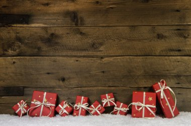 Wooden rustic background with red christmas presents.