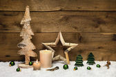 Rustic wooden christmas card with candles and handmade decoratio — Stock Photo