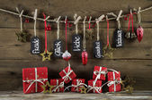 Christmas greeting card with red presents and good wishes in ger — Stock Photo