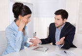 Conflict and problems on workplace: discussing boss and trainee. — Stock Photo