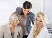 Successful team of well educated businesswoman sitting at desk w — Stock Photo
