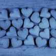 Blue hearts on an old wooden background: greeting card for fathe — Stock Photo #58331629