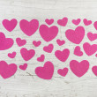 Many pink hearts on wooden shabby chic white background for vale — Stock fotografie #58333015