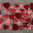 Lovely red checkered hearts on wooden background. Idea for a gre — Stock Photo #58333149