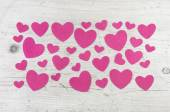 Many pink hearts on wooden shabby chic white background for vale — Stock Photo