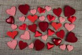Lovely red checkered hearts on wooden background. Idea for a gre — Stock Photo