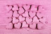 Pink wooden background for valentines day with a collection of h — Stock Photo