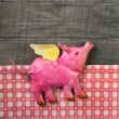 Flying happy pink pig on wooden old checked background. — Stock Photo #58391601
