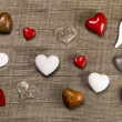 Collection of different red, white and brown hearts on wooden ba — Stock Photo #58391773