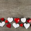 Red and white hearts on wooden background for a greeting card: c — Stockfoto #58391963