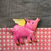 Flying happy pink pig on wooden old checked background. — Stock Photo